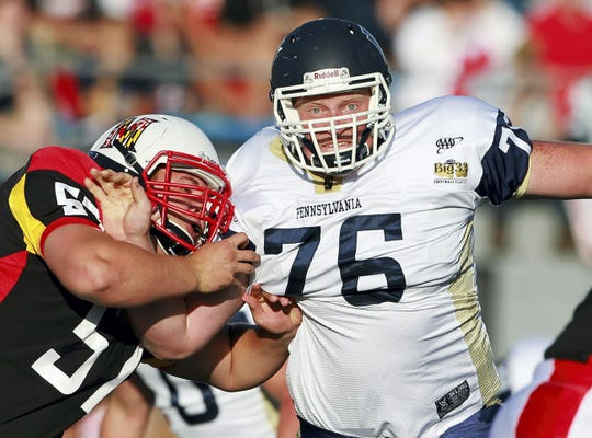 Pennsylvania's David Shaw (76) fights off a block by Maryland's Melvin Gowl (57) during first half action of the 57th Annual Big 33 Football Classic at Hersheypark Stadium in 2014. Shaw, a Spring Grove graduate, played seven games on the defensive line in his true freshman season for the University of Maryland in 2014.