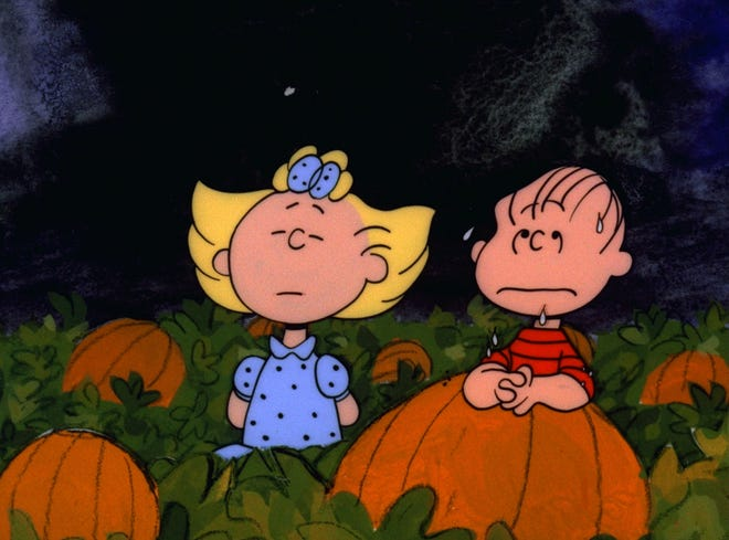 Sally and Linus wait in the pumpkin patch in 'It's the Great Pumpkin, Charlie Brown,' created by Charles M. Schulz.