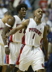 Pistons' Chauncey Billups (1) and Ben Wallace, background, celebrate during the third quarter against the New Jersey Nets in Game 7 of the Eastern Conference semifinals May 20, 2004 at the Palace.