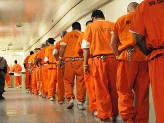 Inmates travel through the Riverside County Jail in Indio.