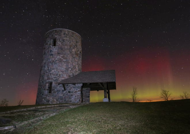 The northern lights shine over Pilot Knob State Park near Forest City, Iowa, in the early morning of Tuesday, Nov. 3, 2015.