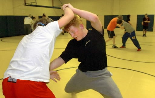 Chance Marsteller, right, works out with Brendan Isaac during a recent workout at South Eastern Middle School.