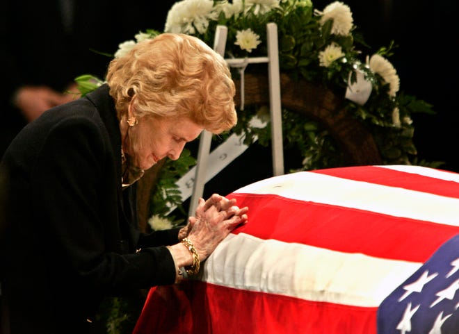 Among Rick McKay's portfolio: A photo of former first lady Betty Ford praying by the casket of her husband, former President Gerald R. Ford, during a service in the Capitol Rotunda on Capitol Hill in Washington on Dec. 30, 2006.