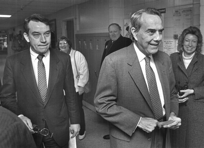 U.S. Sen. Chuck Grassley, left, campaigns with presidential candidate Bob Dole at Regis High School in Cedar Rapids, Iowa on Feb. 5, 1988.