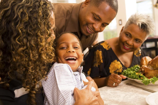Stock photo of Thanksgiving: Family gathers for dinner at grandmother's house. Credit: fstop123/Vetta, Getty Images GETTY ID#: 187419686