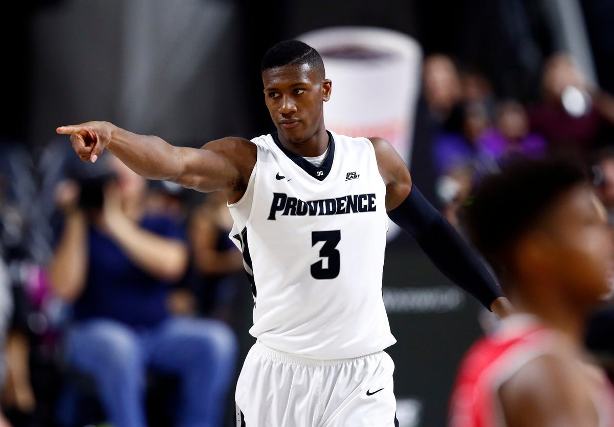 big sale 1f489 2bf83 Player of the year candidate Kris Dunn posts triple-double ...