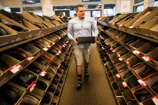 In this file photo from 2015, Danny McKenzie, of Hanover, browses men's shoes for a new pair of work shoes at Clarks Bostonian Shoe Outlet in Hanover's Center Square.