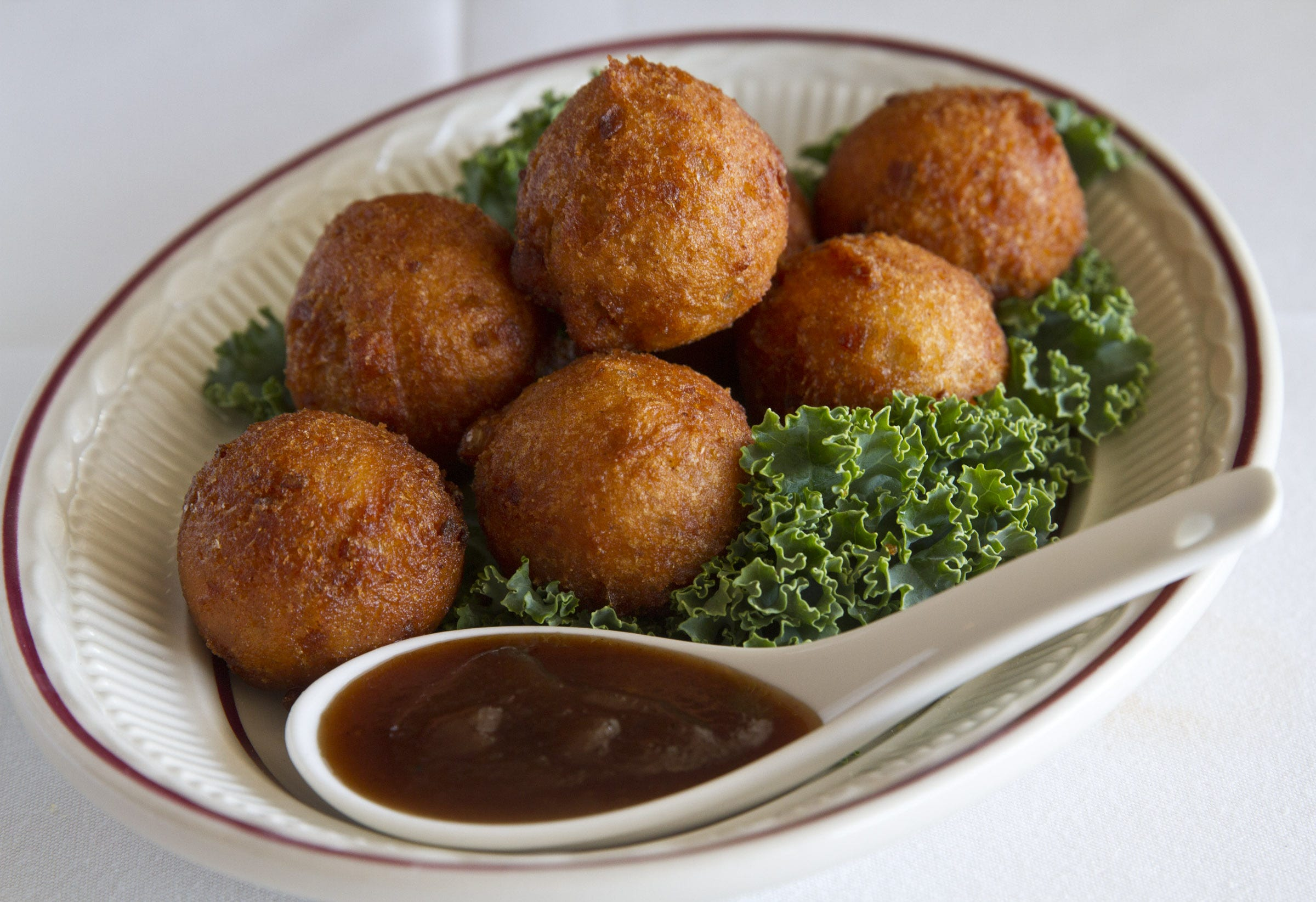 """""""Hush puppies"""" are said to have gotten their name from Southern hunters and fishermen who would fry up cornmeal balls to feed to their -- presumably noisy -- dogs. These  sweet potato hush puppies are served at Simply Southern in Belmar."""
