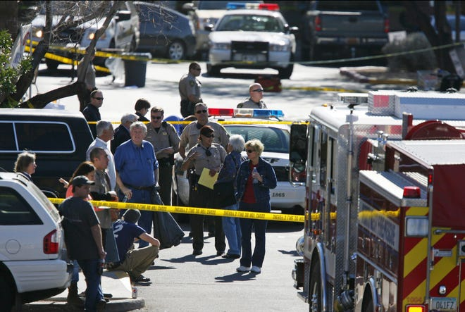 Officers secure the scene of a shooting outside a Safeway store Jan. 8, 2011, in Tucson.  U.S. Rep. Gabrielle Giffords was shot in the head.