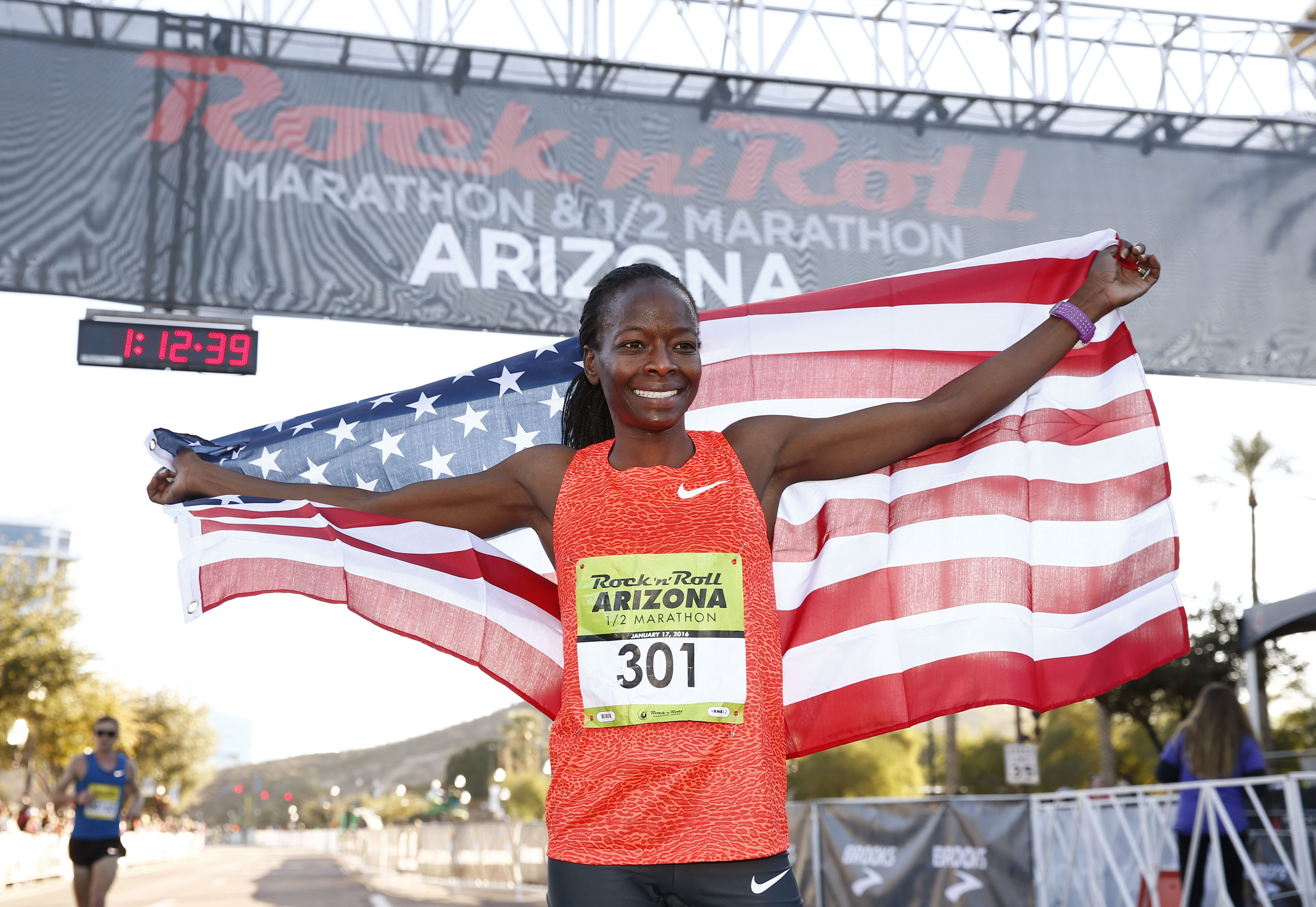 Janet Cherobon-Bawcom of Flagstaff wins the Rock 'n' Roll Arizona Women's ½ Marathon with a time of 1:11:49 on Jan. 17, 2016, in Tempe.