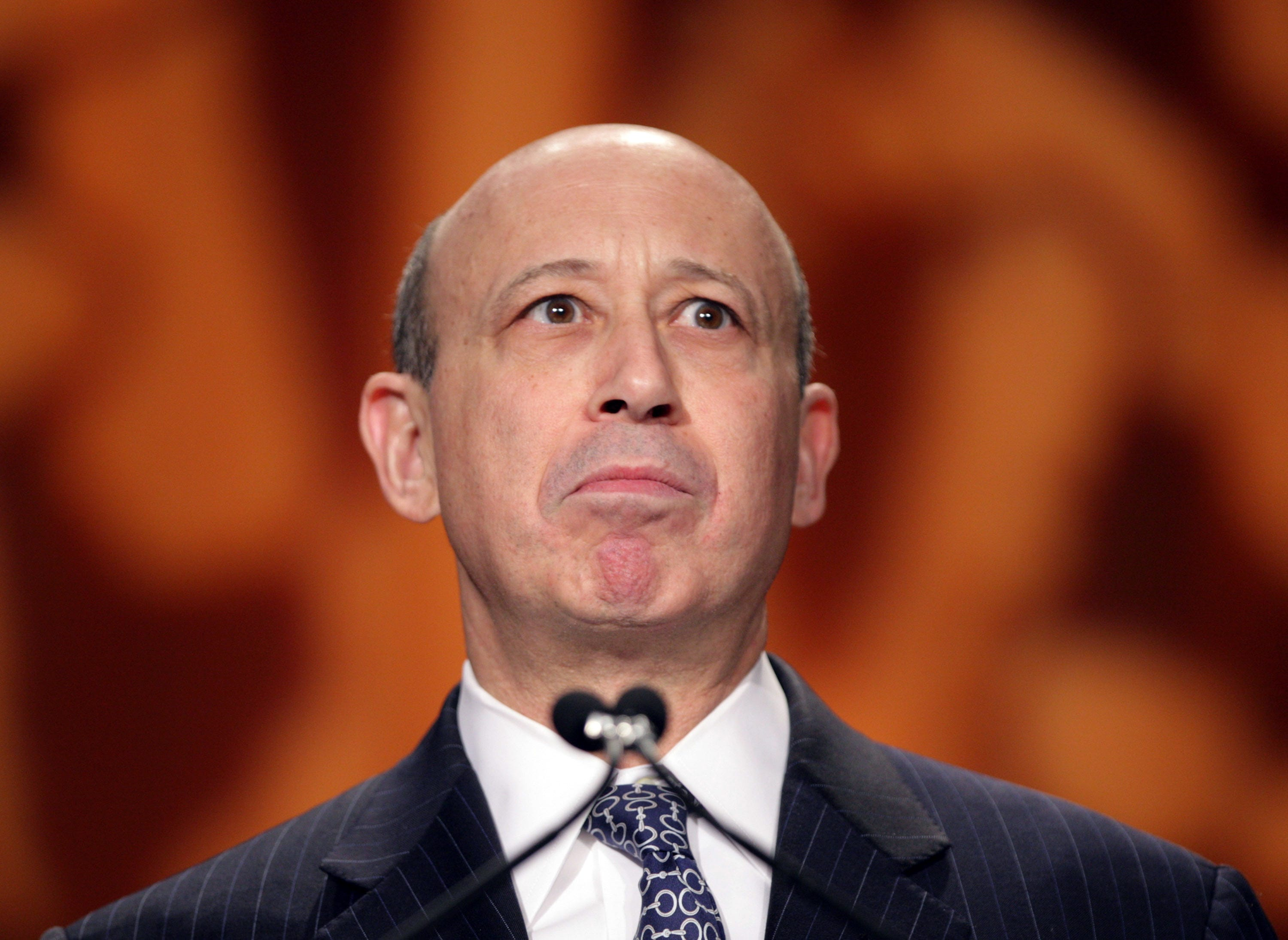 Goldman Sachs earnings dinged on trading, legal costs