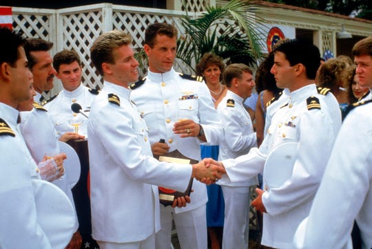Val Kilmer shakes hands with Tom Cruise in the 1986 movie