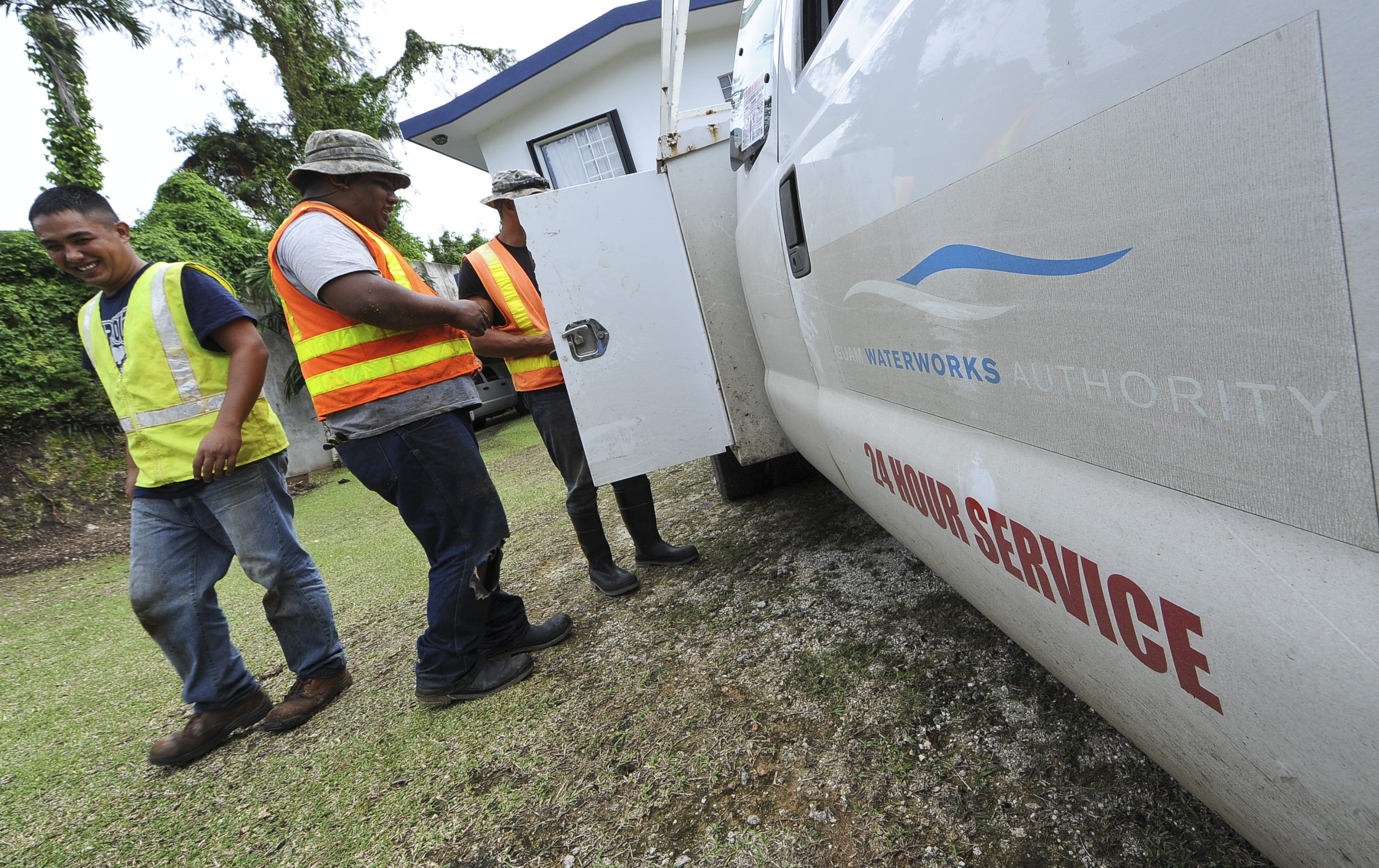 Guam Waterworks Authority employees stow tools and equipment after fixing a leaking valve in Agana Heights in 2012.