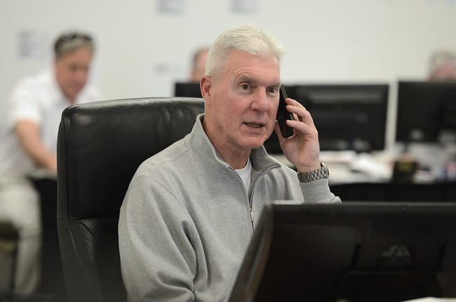 Green Bay Packers general manager Ted Thompson talks on the phone inside the draft room during the NFL draft May 8, 2014, at Lambeau Field.