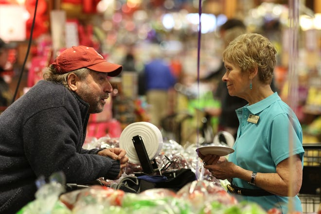 Mary Ellen Burris, senior vice president of consumer affairs, chats with customer Steve Shimberg of Brighton during the store's 100th Anniversary celebration in 2016.