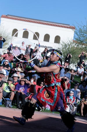 Nakotah LaRance, who is Pima, Tewa and Assiniboin, took home the adult world champion title in 2015 at the Heard Museum World Championship Hoop Dance Contest.