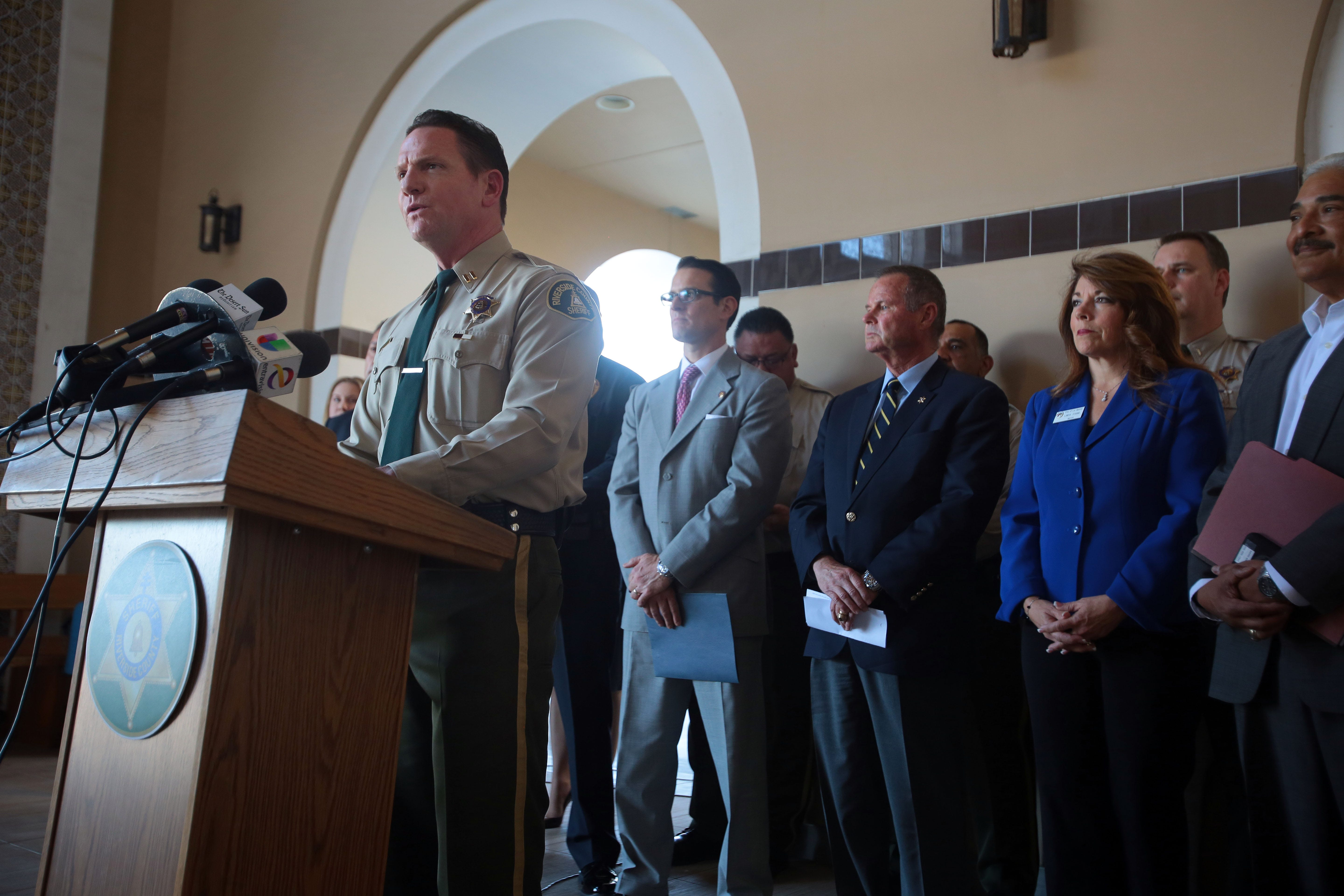 Riverside County Sheriff's Capt. Andrew Shouse, speaks during a 2016 news conference at the Thermal Sheriff's Station. Riverside County District Attorney Mike Hestrin and former Sheriff Stan Sniff stand behind him. Shouse was the commander of the Thermal Station from 2012-17.