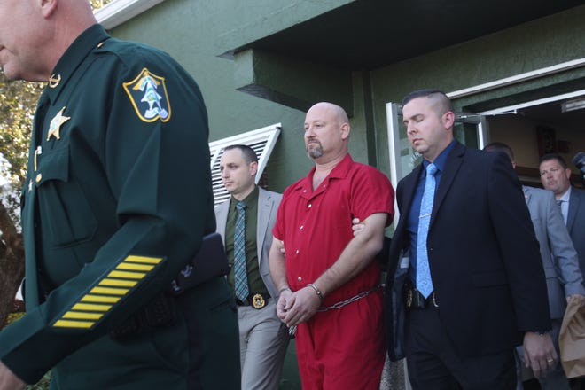 Mark Sievers is escorted by Sheriff Mike Scott after his arrests in connection to the murder of his wife Teresa Sievers.