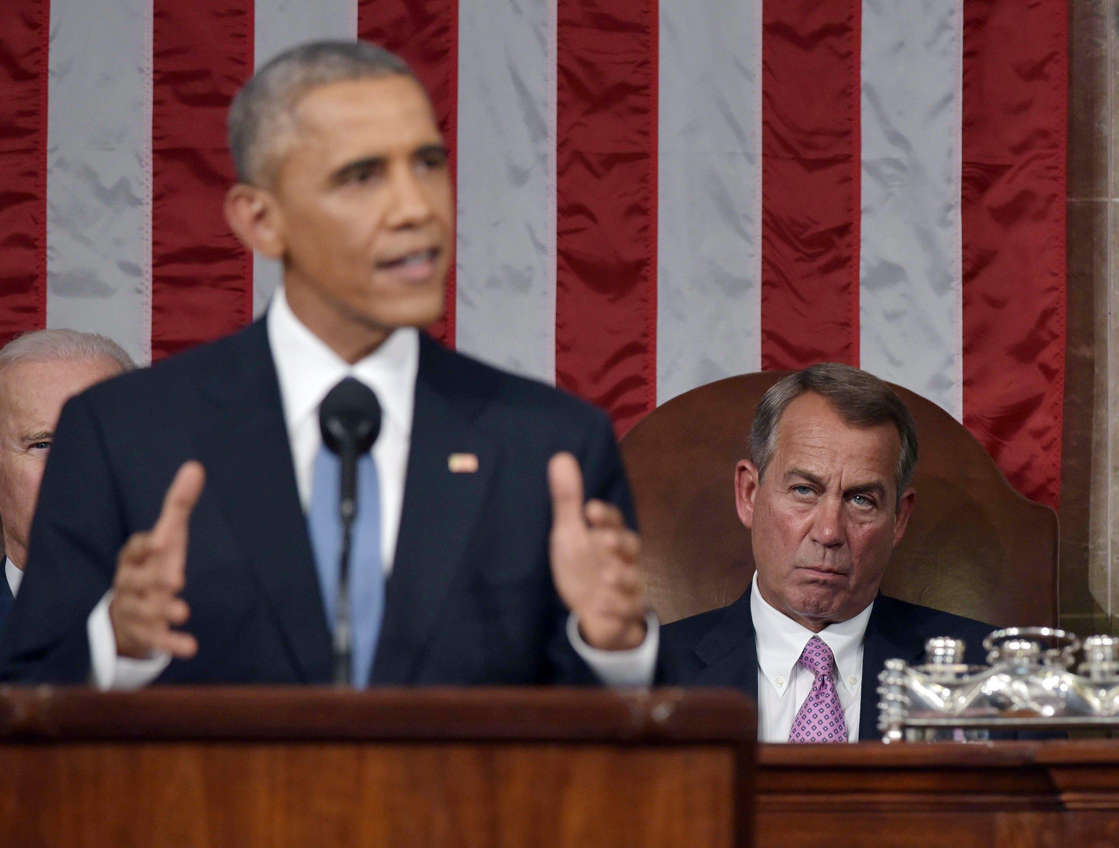 John Boehner listening to former President Barrack Obama deliver his State of the Union address.