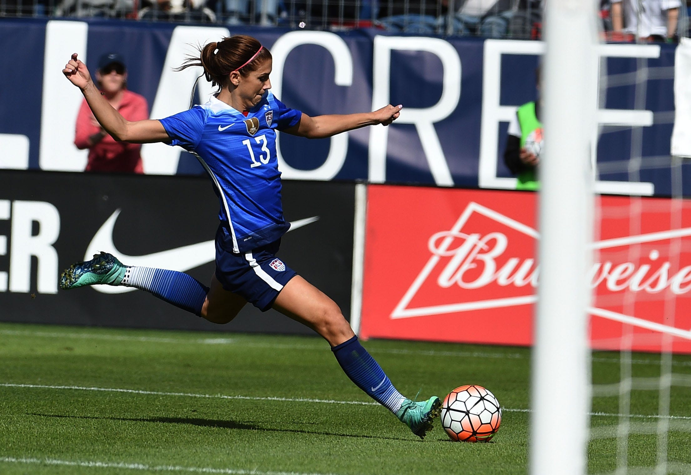 USA's Alex Morgan, 13, takes a shot on goal against