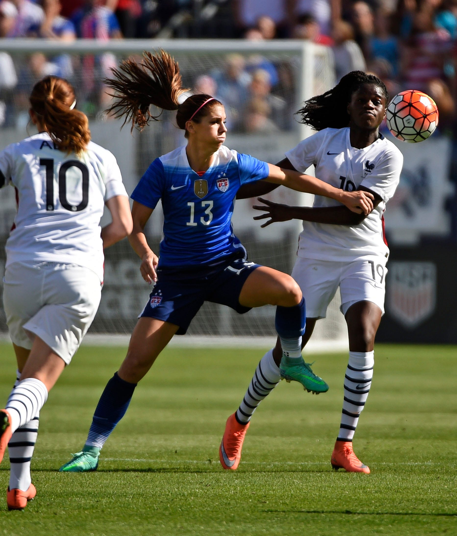 USA's Alex Morgan, 13, goes after the ball against