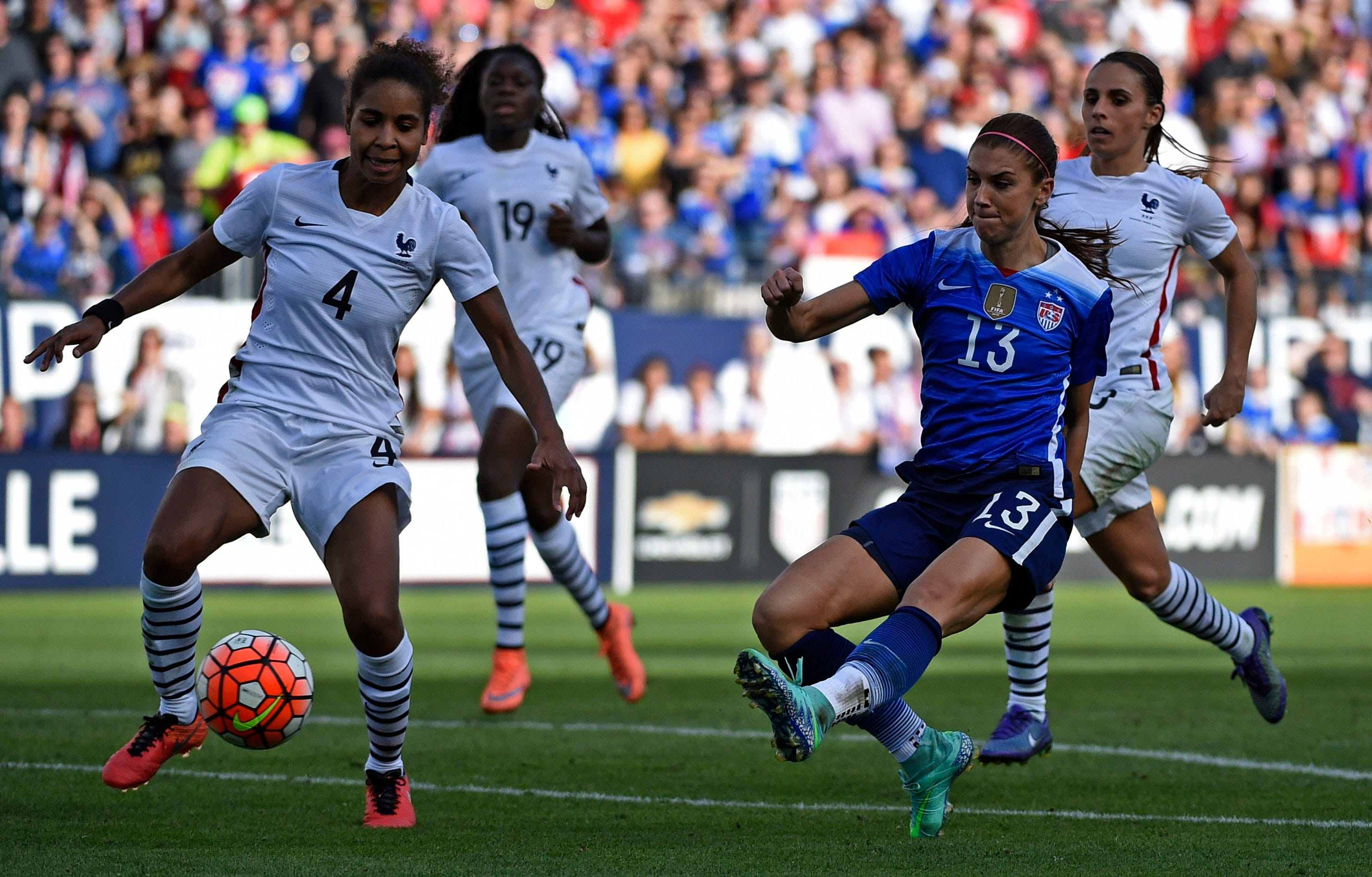 USA's Alex Morgan, 13, scores the winning goal during