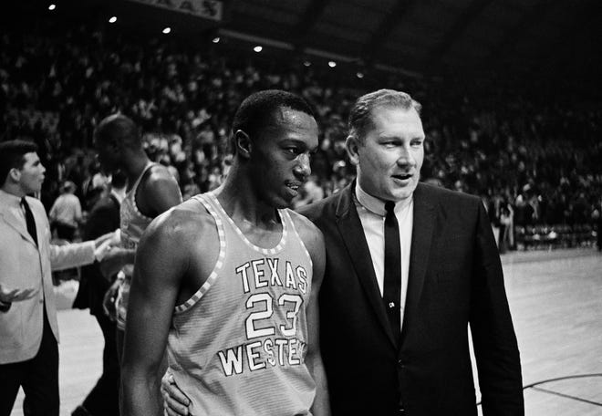 Texas Western Coach Don Haskins, right, escorted Orsten Artis off the court after the Miners came out on top in the NCAA semi-final game against Utah at the University of Maryland, March 19, 1966.