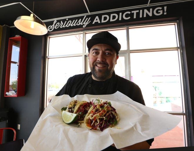 Tacoholics owner Jessie Peña has opened up his first brick-and-mortar restaurant at 1613 N. Zaragoza Road, Suite 201. He is showing a plate with Campechano, Korean BBQ and South Texas tacos.