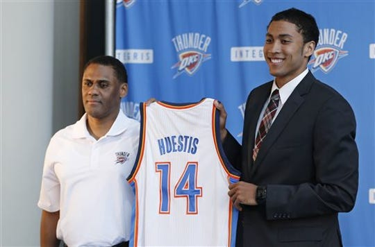 Oklahoma City Thunder vice president and assistant GM Troy Weaver, left, and forward Josh Huestis during a news conference in Oklahoma City, June 27, 2014.