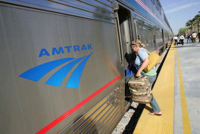 Amtrak now allows passengers to take along small dogs and cats on trips less than seven hours long.  Kris Dykema, of Vermont boards the eastbound Amtrak train at the Palm Springs station in 2010.   (Richard Lui The Desert Sun)