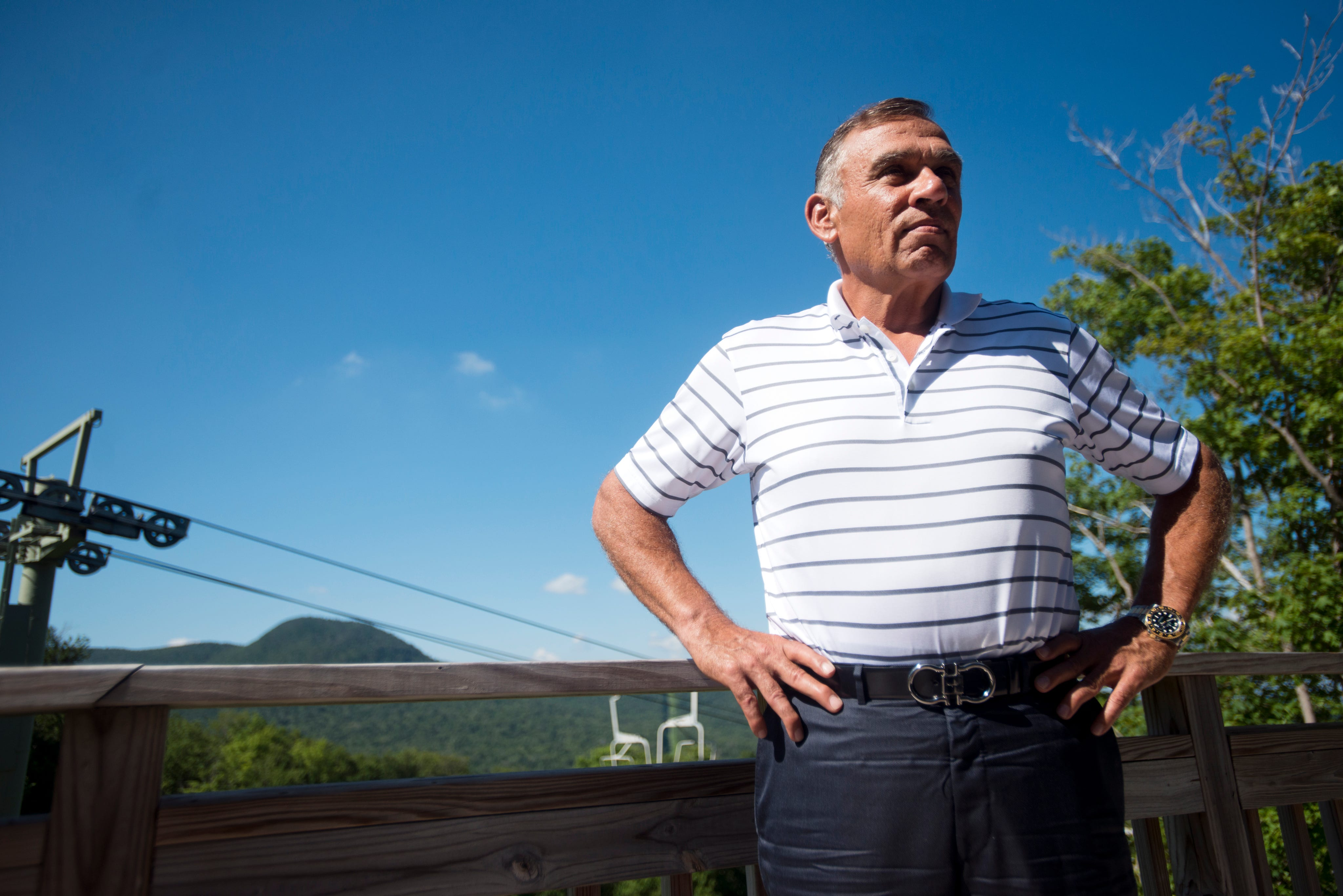 Ariel Quiros, owner of Jay Peak, stands on the porch of his condo at Jay Peak in 2013.