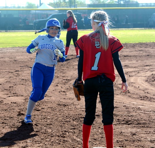 Carlsbad's Vero Arzaga darts past third base and scores a run off Sierra Suter's three-run triple in the bottom of the first inning Saturday against Dora.
