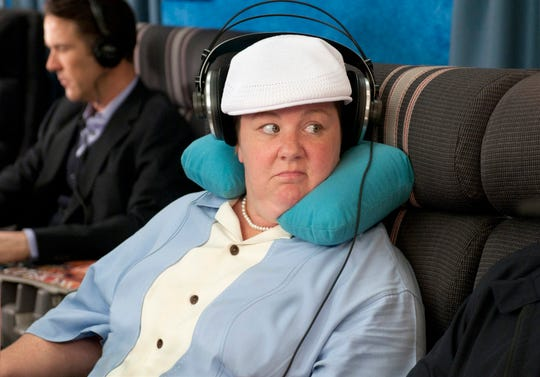 """Melissa McCarthy stole """"Bridesmaids"""" in a scene with an air marshal, played by husband Ben Falcone."""