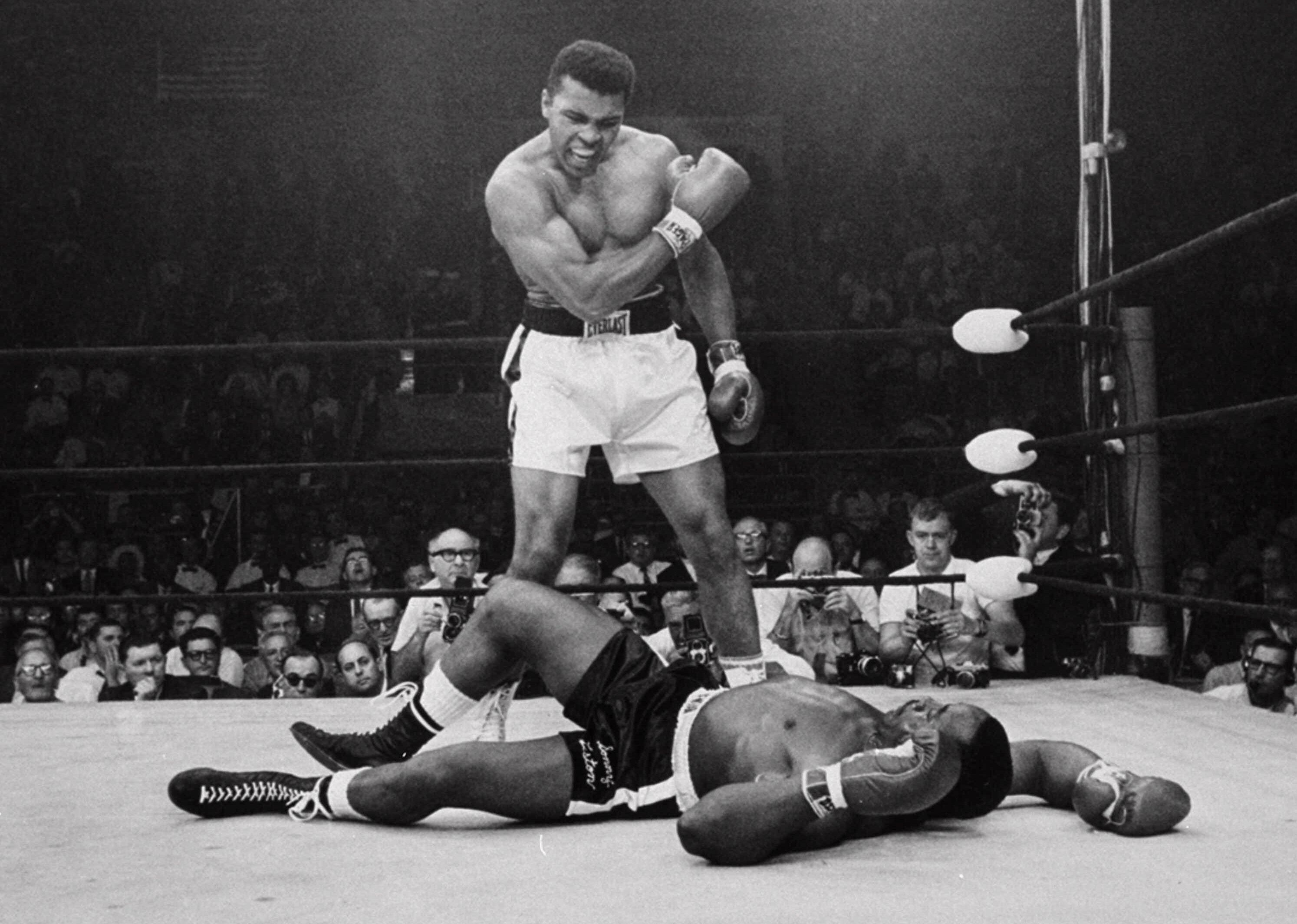 Muhammad Ali stands over fallen challenger Sonny Liston shortly after dropping Liston with a short hard right to the jaw on May 25, 1965, in Lewiston, Maine.