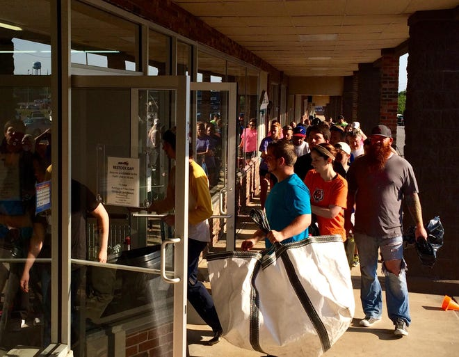 Shoppers line up outside Dickson's Gimme A $5 store in the Dickson Plaza in 2016.