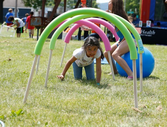 """A couple hundred people came together in 2016 at Ernie Davis Park in Elmira for games, food, crafts, test drives and music to celebrate and remember Juneteenth. Economic Opportunity Program organized the local celebration with the overarching theme of """"A time to heal, a time to unite."""""""