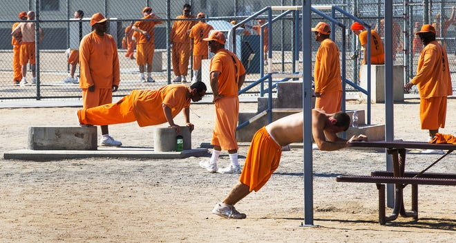 Inmates exercise inside the Arizona State Prison-Kingman, on June 24, 2016.  A riot one year ago damaged much of the prison, but since then, a new operator, GEO Group, has tried to improve the environment.