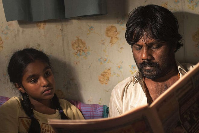 """Jesuthasan Antonythasan as Dheepan, right, and Claudine Vinasithamby as Illayaal star in """"Dheepan."""" The film about refugees who pose as a family to gain access into France was the winner of the Palm d'Or at last year's Cannes."""