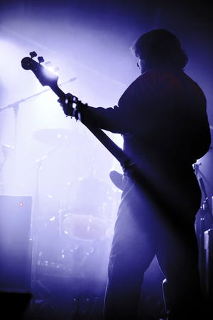 In the Light's Christian Salcedo performs during a Pink Floyd tribute concert in Arden in 2012.