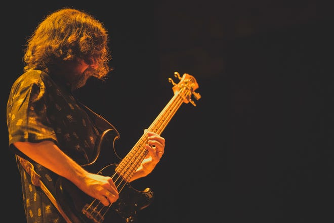 Keep it Dark bassist Christian Salcedo performs during a Genesis tribute at Wilmington's World Cafe Live in May.