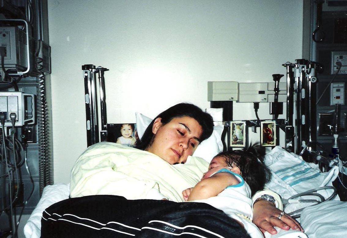 Maribel holds Karizma Vargas in the hospital.