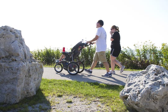 A family walks on the Mariners Trail between Manitowoc and Two Rivers in 2015.