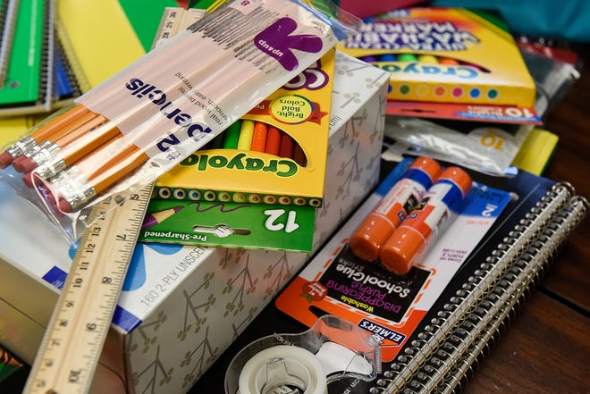 School supplies fill several backpacks Wednesday, Aug. 10, 2016, at Primerica Financial Services in Sauk Rapids.