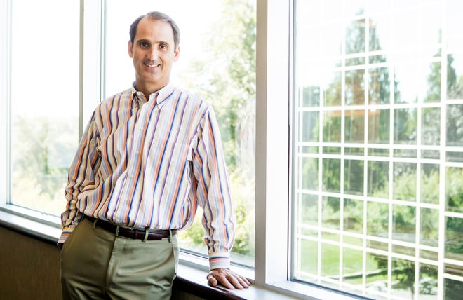 Corporation Service Company CEO Rod Ward poses for a portrait in a conference room at the company's Centreville office.