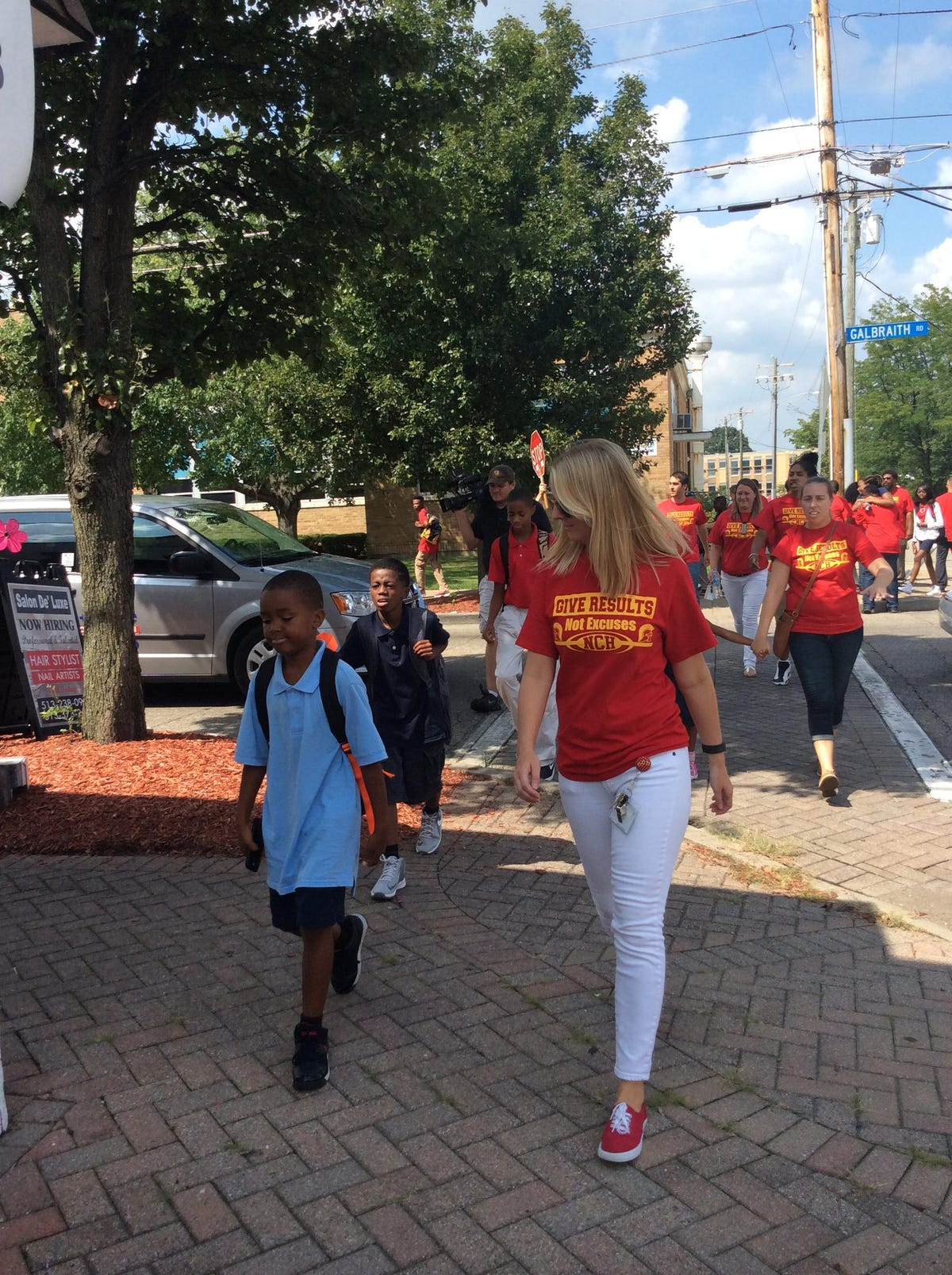 NCH staff kicks off school year walking students home