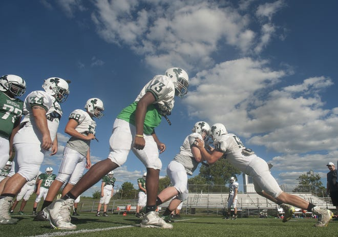 Camden Catholic's defensive line works through drills in practice on Aug. 22. The young Irish - 60 of the team's 75 players are freshmen and sophomores - will aim to grow up quickly this season to show the program's growth.