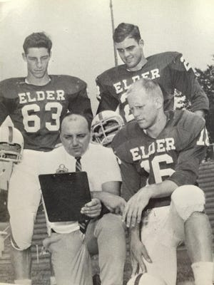 Mike Honold (bottom left) coached football at Elder from 1966-69