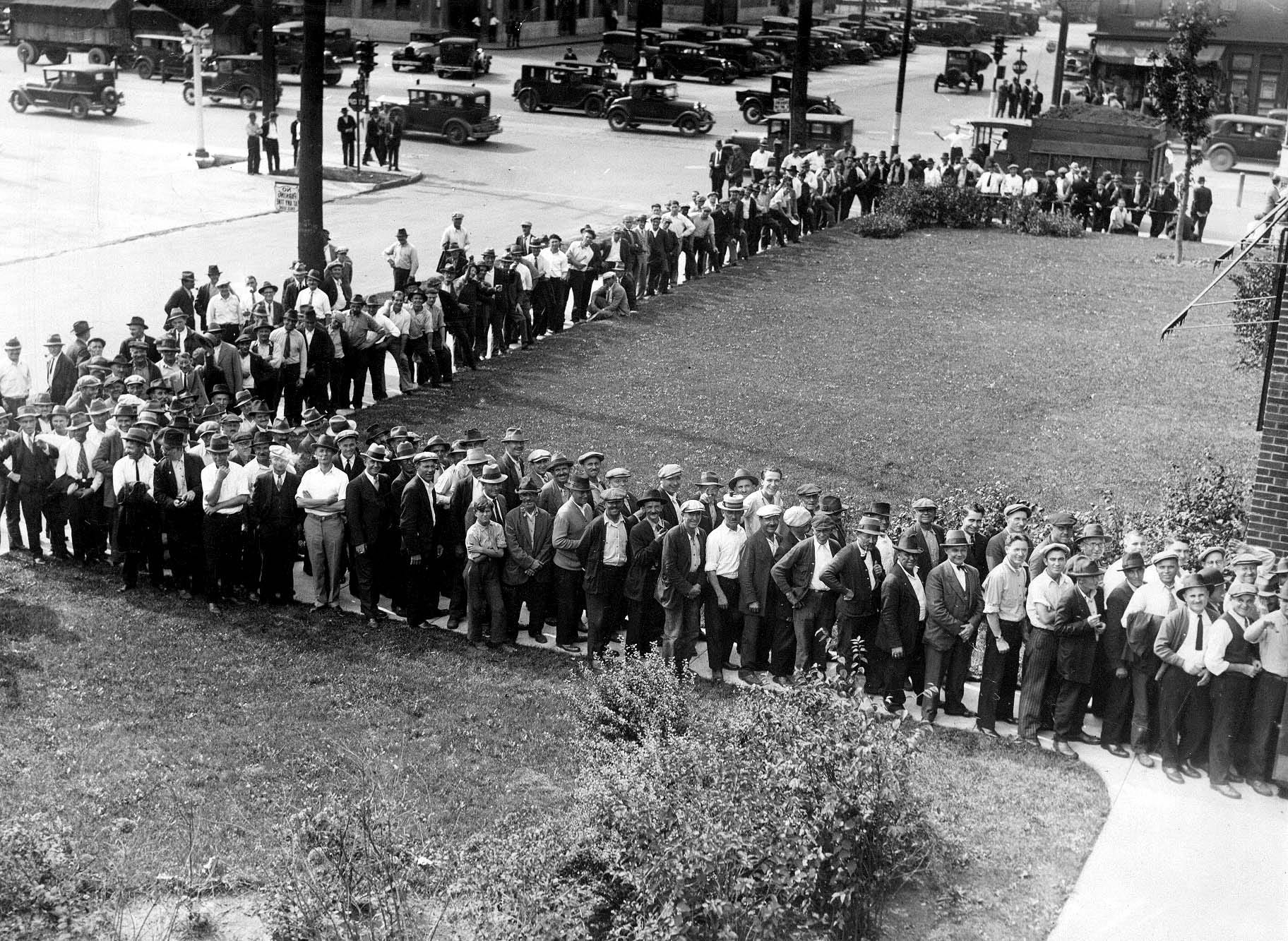 Lines of unemployed men wait outside the Fort Street