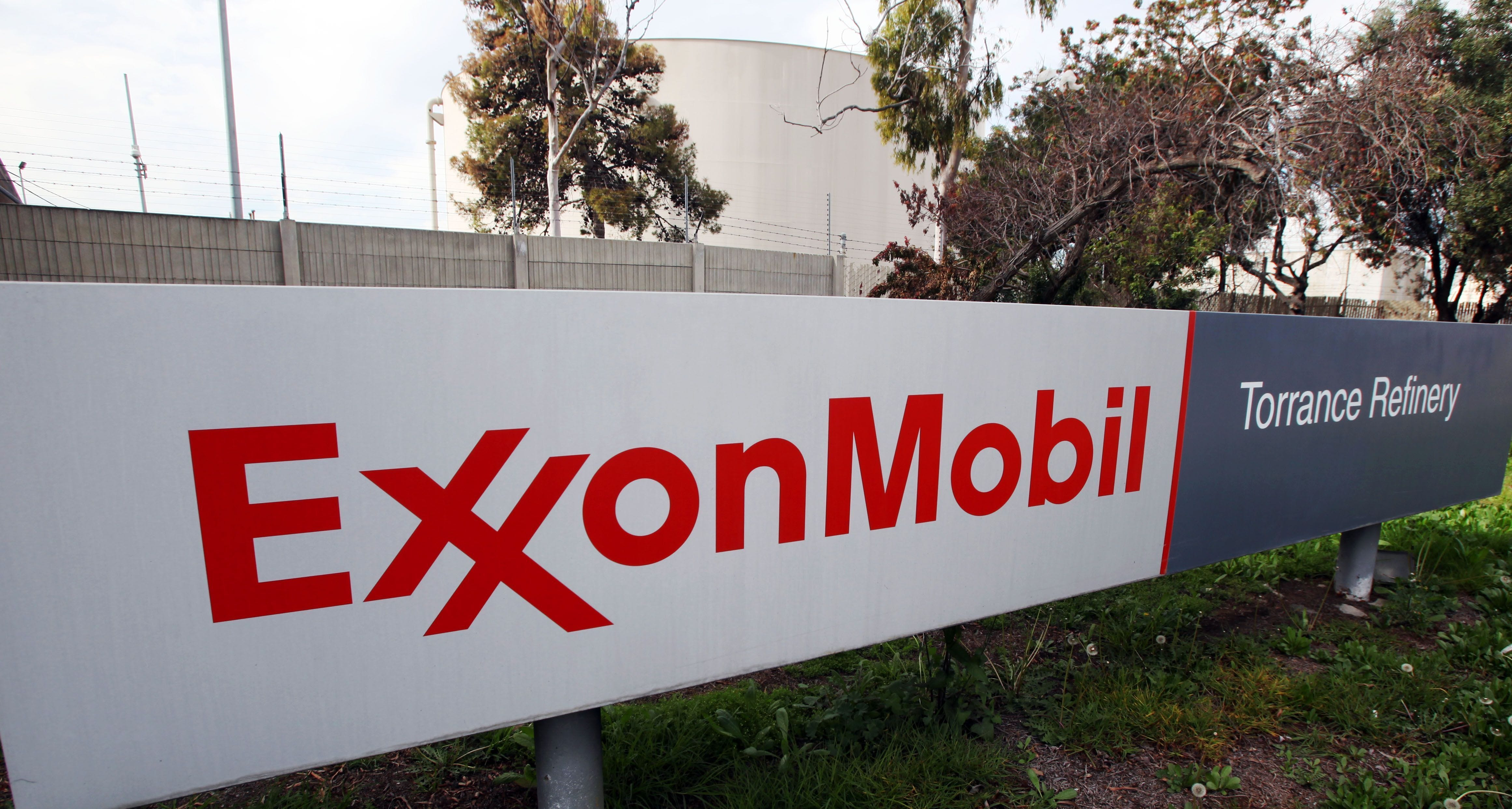 Exxon profit swells but disappoints as global oil surplus continues