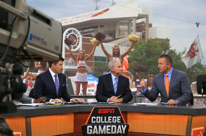ESPN's Rece Davis, Lee Corso and Kirk Herbstreit discuss the upcoming Saturday college football games on the Game Day set outside Papa John's Cardinal Stadium in 2016.